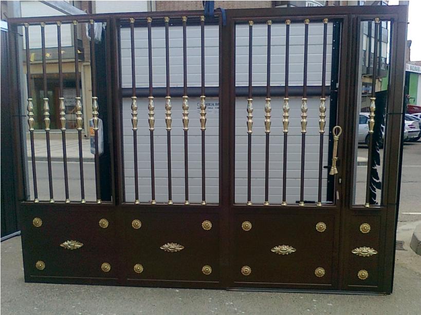 Puertas con forja amazing barreras de aluminio puertas for Modelos de puertas de forja